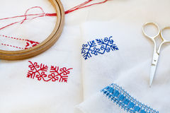 Samples Ukrainian embroidery, unfinished work in progress and tools for embroidery Stock Photos