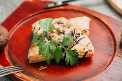 Samsa. With meat on wooden background Stock Photos