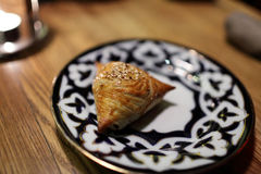 Samsa on a plate Stock Photos