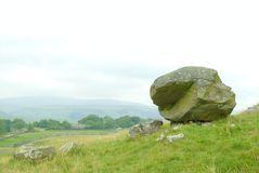 Samson`s Toe. A huge glacial erratic boulder that is locally called Samson's Toe. It is located in an area of limestone ridges and scars known as ' royalty free stock photos