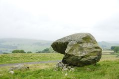 Samson`s Toe. A huge glacial erratic boulder that is locally called Samson's Toe. It is located in an area of limestone ridges and scars known as ' stock image