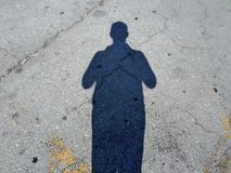 Shadow of a Man in a Parking lot. SAMSUNG CAMERA PICTURES Shadow of a Man in a Parking lot Yellow lines Profile royalty free stock images