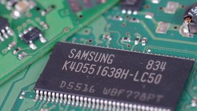 Samsung chip. SARANSK, RUSSIA - OCTOBER 06, 2017: Samsung chip on circuit board stock video footage