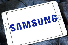 Samsung company logo. Logo of electronics company samsung on samsung tablet Royalty Free Stock Photo