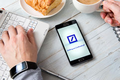 Samsung A5 with Deutsche Bank application laying on desk. WROCLAW, POLAND- OCTOBER 14th, 2016 : Deutsche Bank is a German global banking and financial services stock photography