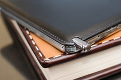 Samsung Galaxy Note 3 on leather planner Stock Images