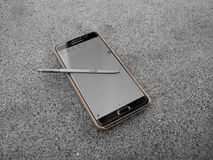 Samsung Galaxy Note 5 on table. Royalty Free Stock Photos