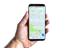 Samsung Galaxy S8 with Google mapa application. GDANSK, POLAND - NOVEMBER 23, 2017: Brand new black Samsung Galaxy S8 in hand isolated over white background Royalty Free Stock Photos