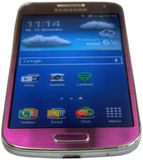 Samsung Galaxy S4 mini purple Royalty Free Stock Photography
