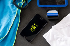 Samsung A5 with Nike+ Run Club application laying on desk. Stock Image