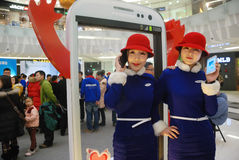 Samsung with show girls Stock Image