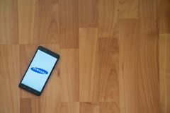Samsung on smartphone screen. Los Angeles, USA, july 18, 2017: Samsung on smartphone screen placed on the laptop on wooden background Stock Photography