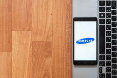 Samsung on smartphone screen. Los Angeles, USA, july 18, 2017: Samsung on smartphone screen placed on the laptop on wooden background Stock Images