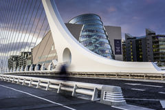 Samuel Beckett Bridge. (Irish: Droichead Samuel Beckett) is a cable-stayed bridge in Dublin that joins Sir John Rogersons Quay on the south side of the River royalty free stock photo