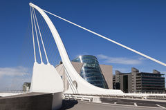 Samuel Beckett Bridge. The Samuel Beckett Bridge is the newest bridge to cross the River Liffey in Dublin, Ireland. The modern structure is curved in the shape stock photography