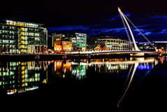 Samuel Beckett Bridge, Dublin, Ireland. Samuel Beckett Bridge, a cable-stayed bridge by architect Santiago Calatrava, opened for maintenance at nighttime, on Stock Photos