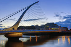 Samuel Beckett Bridge - Dublin - Ireland. The Samuel Beckett Bridge and the buildings on the waterfront - Dublin city center in the republic of Ireland. This is royalty free stock photos