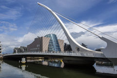 Samuel Beckett Bridge - Dublin - Ireland. Samuel Beckett Bridge and the buildings on the waterfront near the Convention Center - Dublin city center in the stock image