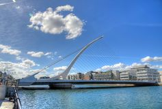 The Samuel Beckett Bridge in Dublin, Ireland. DUBLIN, IRELAND - MAY 30, 2017: The Samuel Beckett Bridge over the river Liffey stock image