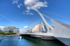 The Samuel Beckett Bridge in Dublin, Ireland. DUBLIN, IRELAND - MAY 30, 2017: The Samuel Beckett Bridge over the river Liffey royalty free stock photography
