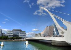 The Samuel Beckett Bridge in Dublin, Ireland. DUBLIN, IRELAND - MAY 30, 2017: The Samuel Beckett Bridge over the river Liffey stock photo