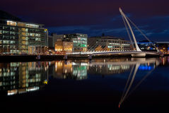 Samuel Beckett Bridge, Dublin, Ireland at night. DUBLIN, IRELAND - AUGUST 23: Samuel Beckett Bridge, a cable-stayed bridge by architect is Santiago Calatrava Royalty Free Stock Photo