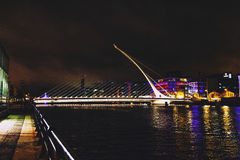 The Samuel Beckett bridge and Dublin`s docklands on the river Li Stock Photo