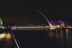 The Samuel Beckett bridge and Dublin`s docklands on the river Li. DUBLIN, IRELAND - Septembter 26th, 2016: View over the Samuel Beckett bridge and Dublin`s Stock Photos