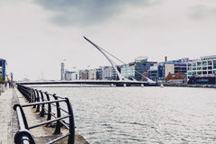 The Samuel Beckett bridge and Dublin`s docklands on the river Li Royalty Free Stock Images