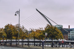 The Samuel Beckett bridge and Dublin`s docklands on the river Li. DUBLIN, IRELAND - Septembter 27th, 2016: View over the Samuel Beckett bridge and Dublin`s Royalty Free Stock Images