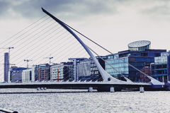 The Samuel Beckett bridge and Dublin`s docklands on the river Li. DUBLIN, IRELAND - Septembter 27th, 2016: View over the Samuel Beckett bridge and Dublin`s Royalty Free Stock Photography