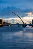 Samuel Beckett Bridge over Liffey river in Dublin, Ireland. Samuel Beckett Bridge over Liffey river in Dublin, Ireland at sunrise Royalty Free Stock Image