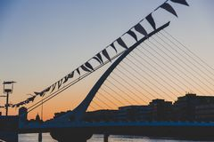 The Samuel Beckett bridge on the river Liffey in Dublin at dusk. DUBLIN, IRELAND - June 3rd, 2018: the Samuel Beckett bridge on the river Liffey in Dublin at stock photography