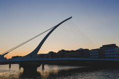 The Samuel Beckett bridge on the river Liffey in Dublin at dusk. DUBLIN, IRELAND - June 3rd, 2018: the Samuel Beckett bridge on the river Liffey in Dublin at stock image