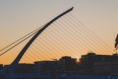 The Samuel Beckett bridge on the river Liffey in Dublin at dusk. DUBLIN, IRELAND - June 3rd, 2018: the Samuel Beckett bridge on the river Liffey in Dublin at royalty free stock images