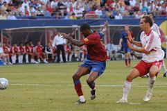 Samuel Eto'o. Shoots to score a goal.  Red Bull's player cannot catch up to him. Image taken at Giants Stadium on August 06, 2008. This was a pre-season Stock Photography