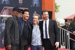 Samuel L. Jackson, Lionel Richie, Jimmy Kimmel and Brian Grazer. At Lionel Richie Hand And Footprint Ceremony held at the TCL Chinese Theatre in Hollywood, USA Royalty Free Stock Images