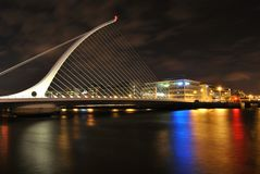 Samuel`s Beckett bridge at night, shining lights of the colors in the water, Dublin, Ireland Royalty Free Stock Photos