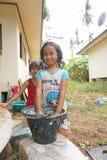 SAMUI ISLAND, THAILAND - 29 MAY 2016: Thai girls bathing in yard. SAMUI ISLAND, THAILAND - 29 MAY 2016: Two Thai girls bathing in yard Royalty Free Stock Photography