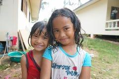 SAMUI ISLAND, THAILAND - 29 MAY 2016: Thai girls bathing in yard. SAMUI ISLAND, THAILAND - 29 MAY 2016: Two Thai girls bathing in yard Stock Photography