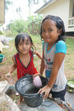 SAMUI ISLAND, THAILAND - 29 MAY 2016: Thai girls bathing in yard. SAMUI ISLAND, THAILAND - 29 MAY 2016: Two Thai girls bathing in yard Stock Photos