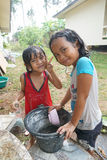 SAMUI ISLAND, THAILAND - 29 MAY 2016: Thai girls bathing in yard. SAMUI ISLAND, THAILAND - 29 MAY 2016: Two Thai girls bathing in yard Stock Images