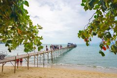 Samui, Thailand - 5 AUGUST 2016; Tourists embarking ship. Samui, Thailand - 5 AUGUST 2016 Caucasian tourists embarking ship on pier Stock Photos