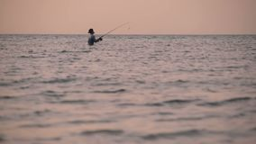 SAMUI, THAILAND - 23 JUNE, 2018: Fisherman silhouette in action when spinning, sunset time. Traditional Asian occupation. SAMUI, THAILAND - 23 JUNE, 2018 stock video footage