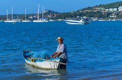 SAMUI, THAILAND - JUNE 29:Unidentified fisherman with small trad Stock Photography