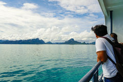Samui, Thailand - 3 November 2016: Man looking at the sea traveling by ferry. Future adventures concept