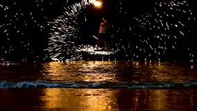 SAMUI, THAILAND - 8TH JANUARY, 2018: Fisherman beach Thai fireshow. Dangerous tricks with flame. Fire performance, sparks fly in all directions, hit the sea stock footage