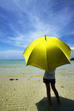 Samui and yellow umbrella Stock Photography