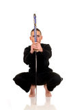 Samurai. Young adult boy practicing the martial art of the samurai warriors, studio shot Royalty Free Stock Photo