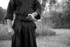 Samurai. Man in kimono holding samurai sword, black and white Stock Images
